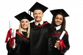 stock photo of mantle  - Multi ethnic group of graduated young students isolated on white - JPG