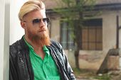 stock photo of long beard  - outdoor photo of a young casual redhead bearded man with sunglasses - JPG