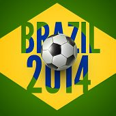 picture of brasilia  - Soccer ball above flag of Brazil 2014 - JPG