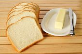 stock photo of angle  - Sliced white bread and butter shot from a high angle view - JPG