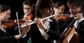 picture of orchestra  - Female flutist close - JPG