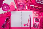 stock photo of girly  - Girly pink desktop and stationery with blank notebook and pencil - JPG
