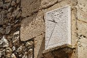foto of sundial  - sundial installed in the wall of an old building