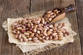 stock photo of pinto bean  - Pinto beans with a spoon on a wooden table - JPG