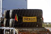 picture of enormous  - A large Australian truck carries enormous mining equipment tires definitely a gold mine - JPG