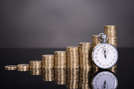 image of time-saving  - Time is money concept over black background - JPG