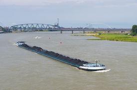 foto of coal barge  - coal barge on the Waal river at Nijmegen netherlands - JPG