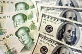 image of yuan  - One Hundred American Dollar Bills with One Chinese Yuan Bills - JPG