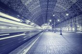 picture of high-speed train  - High speed train departs from the station at night time - JPG