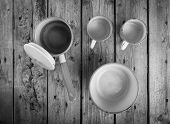 image of saucepan  - Old cups and saucepan in a retro kitchen table setting in black and white - JPG