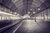 stock photo of high-speed train  - High speed train departs from the station at night time - JPG