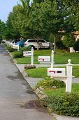 stock photo of duplex  - Nice duplex neighborhood with rows of mailboxes - JPG