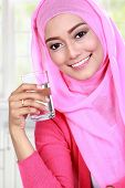 pic of muslimah  - beautiful young muslim woman holding a glass of water - JPG