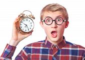 picture of nerd  - Nerd guy y in glasses with alarm clock - JPG
