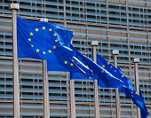 foto of european  - European flags in front of the Berlaymont building headquarters of the European commission in Brussels - JPG