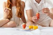 foto of bed breakfast  - Couple eating breakfast together at the weekend - JPG