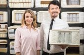 picture of mattress  - Good choice. The young salesman and the customer with quality mattresses in the store.