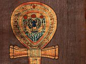 pic of ankh  - Details of the Upper Part of the Ankh Cross on the Dark Brown Egyptian Papyrus  - JPG