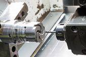 image of machine  - operator machining die casting machine parts by high precision CNC lathe - JPG