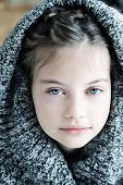 pic of little girls photo-models  - Studio shot of a beautiful young girl in a hooded sweater with shallow depth of field - JPG