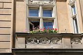 picture of bannister  - Flowers on a bannister on a European balcony apartment - JPG