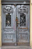 foto of graffiti  - Old wooden door in Prague painted with gray paint - JPG