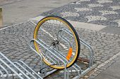 picture of stolen  - remaining bicycle wheel of a stolen bike - JPG