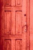 image of fragmentation  - fragment of red old closed door or vintage background - JPG