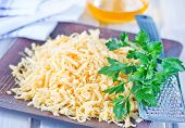 image of grating  - grated cheese on plate and on a table - JPG