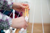 stock photo of laundry  - woman hanging laundry to laundry stand - JPG