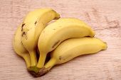 picture of bunch bananas  - Banana bunch in isolated wood background fruit - JPG