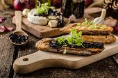 stock photo of home-made bread  - Toasted bread with brie cheese and caramelized onions home made onion  - JPG