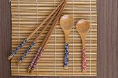 pic of bamboo  - Some bamboo sushi tools over a bamboo mat - JPG