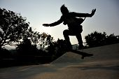 foto of skateboarding  - young skateboarder legs skateboarding at outdoor skatepark