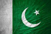image of pakistani flag  - Pakistan flag or bPakistani anner on wooden texture - JPG