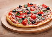foto of hot fresh pizza  - Delicious fresh pizza with ham served on a wooden table - JPG