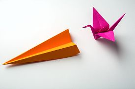 stock photo of float-plane  - row of colored paper origami plane and crane - JPG