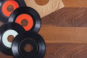 stock photo of jukebox  - Record vinyl top view in wooden background space - JPG