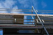 pic of scaffold  - Scaffolding elements with a view in the blue sky - JPG