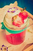 stock photo of whipping  - Vintage photo of dessert with jelly whipped cream and strawberries - JPG