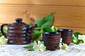 foto of teapot  - Teapot with small cups and jasmine flowers - JPG