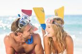 image of flipper  - Happy couple with snorkel and flippers at the beach - JPG