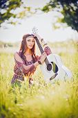 image of hippy  - Portrait of a pretty young hippie girl with guitar - JPG