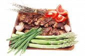 pic of white asparagus  - hot lunch of fresh beef meat roasted ribs with asparagus and tomatoes isolated over white background - JPG