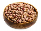 stock photo of pinto bean  - pinto beans on wood bowl isolated on white - JPG
