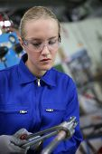 image of ironworker  - Young woman studying ironworks in professional school - JPG