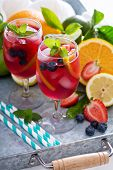 picture of sangria  - Ice cold red sangria with citrus fruits and berries in glasses - JPG
