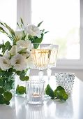 image of champagne glasses  - Two glasses of champagne and white flowers - JPG
