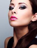 stock photo of foundation  - Beautiful woman with bright smokey makeup eyes and pink lipstick - JPG