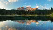stock photo of lagos  - Alps lake landscape with forrest mountain Lago di Carezza  - JPG